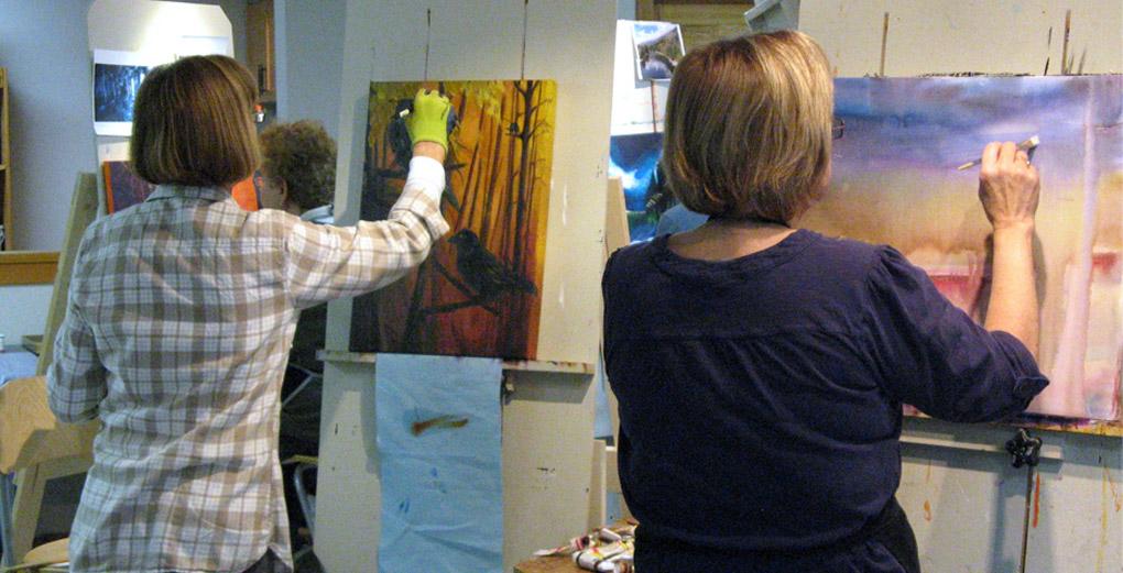 Artists working on paintings in the Mirja Vahala Art Studio, Robson, BC